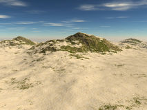 The rocky terrain covered with sand Stock Photography