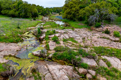 A Rocky Texas Creek with WIldflowers. Royalty Free Stock Image
