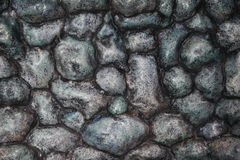 Rocky Texture. A rocky texture that is primarily gray but has some blacks, blue tones and green stock image