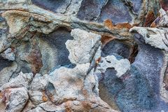 Rocky textures on Milos island, Cyclades, Greece. Ruins of old factory Stock Images