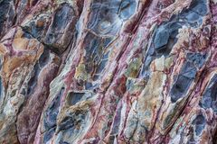 Rocky textures on Milos island, Cyclades, Greece. Ruins of old factory Royalty Free Stock Images