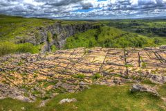Rocky top of Malham Cove Yorkshire Dales UK hdr. Malham Cove Yorkshire Dales National Park England UK popular tourist attraction in colourful hdr Royalty Free Stock Photo