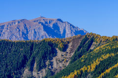 Rocky towny in autumn mountains. Rocky mountain peak with autumn Stock Images