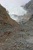 Rocky trail and glacier. Westland Tai Poutini National Park,  New Zealand Royalty Free Stock Photo