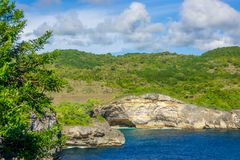 Rocky Tropical Coast in Sunny Day royalty free stock image