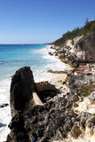 Rocky tropical coastline. Scenic view of rocky tropical coastline with blue sky background stock photo