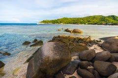 Rocky tropical sea beach Stock Photos