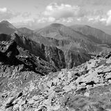 Rocky v. Fagaras mountains, peaks in background Royalty Free Stock Photo