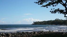 Rocky volcanic beach beach and waves. stock footage