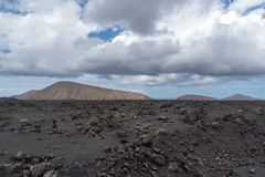 Desert stone volcanic landscape in Lanzarote, Canary Islands stock images