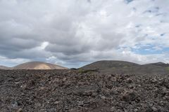 Desert stone volcanic landscape in Lanzarote, Canary Islands stock photos