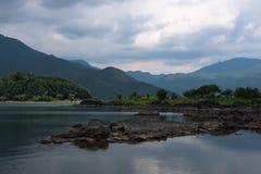 Rocky volcanic shores of the Kawaguchi lake. Rocky volcanic shores as silent reminders of a volcanic eruption in the past of the Kawaguchi lake, Japan Stock Photo