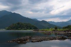 Rocky volcanic shores of the Kawaguchi lake. Rocky volcanic shores as silent reminders of a volcanic eruption in the past of the Kawaguchi lake, Japan Royalty Free Stock Photo