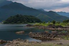Rocky volcanic shores of the Kawaguchi lake. Rocky volcanic shores as silent reminders of a volcanic eruption in the past of the Kawaguchi lake, Japan Stock Photos