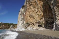 Rocky wall on the beach in Italy.  stock photos