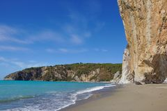 Rocky wall on the beach in Italy.  royalty free stock photos