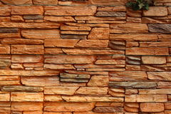 Rocky wall. Fence laid out stones of different colors and shapes Royalty Free Stock Images
