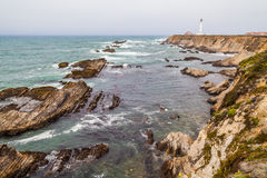 The rocky water road. Strange formation of rocks made by the Pacific Ocean pointing to the Punta Arena lighthouse in Mendocino Coast Royalty Free Stock Image