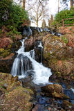 Rocky Waterfall. A small waterfall tumbling down a rocky landscape garden stock images