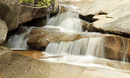 Rocky waterfall. Mountainside Waterfall formed by rock Stock Photos