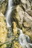 Rocky waterfall. Waterfall on the rocky mountain with moss Royalty Free Stock Images