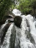 Rocky waterfall. Waterfall in the mountains with. A lot of water royalty free stock images