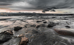 Rocky. A wide angle shot of Norways greates lake in winter Stock Photo