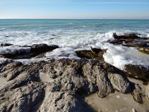 Winter coast of the Caspian Sea. Rocky winter coast of the Caspian Sea royalty free stock photo