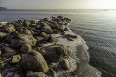 Rocky winter shore Royalty Free Stock Image