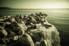 Rocky winter shore Stock Photography