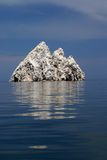 Roco Consag Island Baja Mexico. Roco Consag Island on a flat calm day 26 miles due east of the San Felipe marina off of the coast of Baja, Mexico in the Sea of Stock Photography