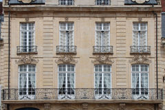 Rococo patterns were sculptured on the facade of a building in Caen (France) Stock Photo