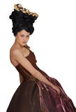 Rococo style young woman standing in dress. Rococo style young woman with hairstyle and hat standing in dress over white background royalty free stock photo