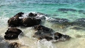 Rocks with the wave with nice breeze stock video footage