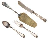 Rocznik łyżka, rozwidlenie, nóż i szpachelka odizolowywający na białym tle, zdjęcie stock