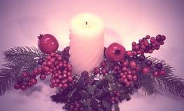 Rocznik świeczka z jodłą i granatowem Fotografia Stock