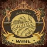 Rocznik etykietka z winnicą i wiązka winogrona na drewnianym tle ilustracji