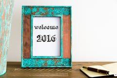 Rocznik fotografii rama na drewnianym stole z teksta powitaniem 2016 Zdjęcia Stock