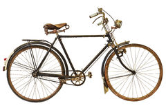 Rocznik rdzewiał bicykl odizolowywającego na bielu Obrazy Royalty Free