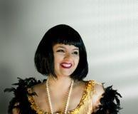 Rocznik Stylowa kobieta jest Uśmiechnięta na Białym tle Zdjęcie Royalty Free
