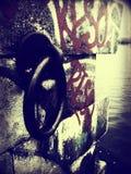 Rocznik woda w Latvia i cegła Obrazy Royalty Free