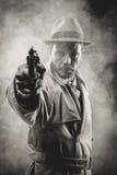 Rocznika agent wskazuje pistolet Obrazy Royalty Free