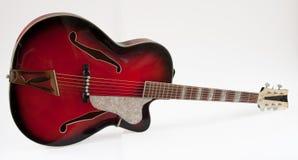 Rocznika archtop czerwona gitara Zdjęcia Stock