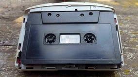 Rocznika czerni audio kaseta w taśma pisaku wiruje zdjęcie wideo