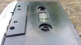 Rocznika czerni audio kaseta w taśma pisaku wiruje zbiory