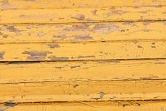 Rocznika drewniany tło z obieranie żółtą farbą Obrazy Royalty Free