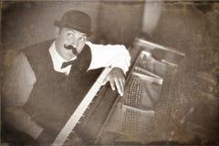 Rocznika fortepianowy gracz obrazy royalty free
