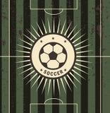 Rocznika futbolu znak na polu Obrazy Royalty Free