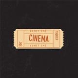 Rocznika kinowy bilet nad grunge tłem struktura konkretną Zdjęcia Stock