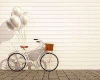 Rocznika modnisia bicykl z balonem przed ścianą Obraz Stock